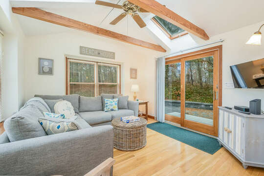 Sun room off the dining area with entry to the back yard and large flat screen tv-46 Har-Wood Ave Harwich- Cape Cod- New England Vacation Rentals