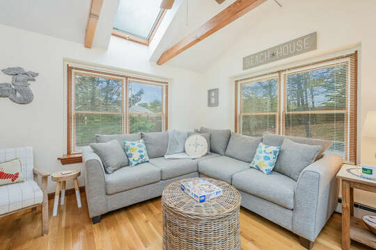 Sun room with L shaped couch and lots of natural light-46 Har-Wood Ave Harwich- Cape Cod- New England Vacation Rentals