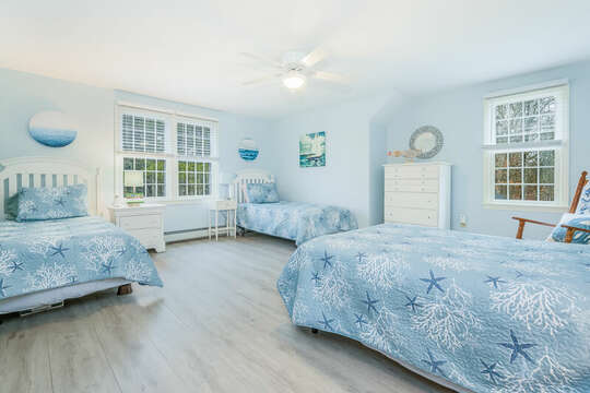 Bedroom #3 with 1 double bed and 2 twins and dresser, rocking chair-46 Har-Wood Ave Harwich- Cape Cod- New England Vacation Rentals