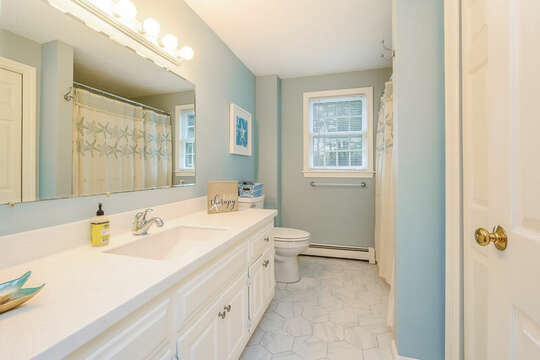 Bathroom #1 full bath with large vanity and shower/tub combo-46 Har-Wood Ave Harwich- Cape Cod- New England Vacation Rentals