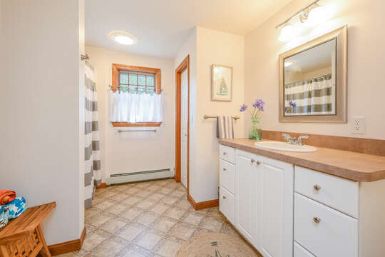 Bathroom #2 Full bath with large vanity, shower/tub combo and linen closet- 46 Har-Wood Ave Harwich- Cape Cod- New England Vacation Rentals