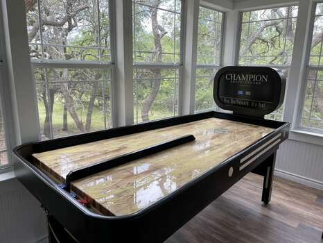 Funk House with Bank Shuffle Board, Rowing Machine, and 65