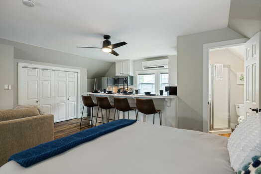 Spacious studio apartment with a full kitchen and bar seating