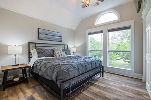 Upper level bedroom 4 with a king bed and a 55