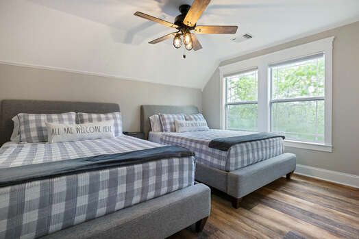 Upper level bedroom 3 with two queen beds and 55