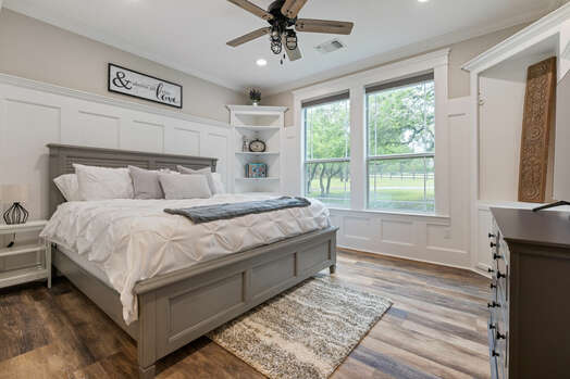 Main level bedroom with king bed and 55