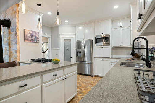 Expansive kitchen with plenty of counter space and stainless steel appliances