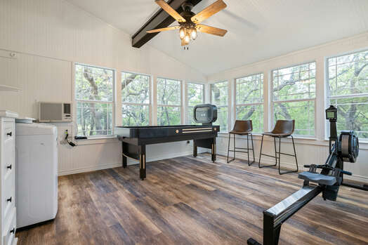 Game/Funk House room - a bank shuffle board table, rowing machine, 65