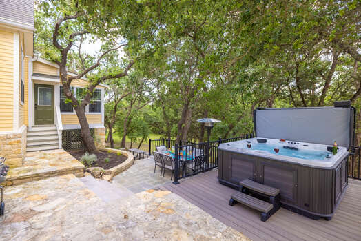 Sparkling 7-person Hot Tub on back patio and pool just beyond