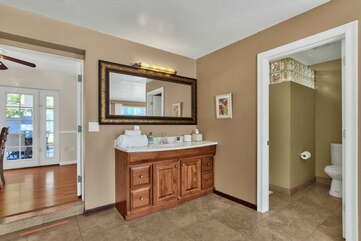 Private Bath with a Granite Counter Sink and a Separate 2-Piece Bath with Shower