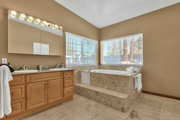 Master Bath with a Jetted Tub, Two Granite Counter Sinks, and Plenty of Natural Light