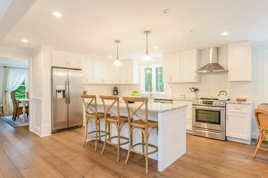Kitchen with breakfast bar and all stainless appliances - 21 Moon Compass Lane Sandwich Cape Cod - New England Vacation Rentals