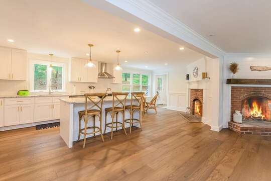 Double fireplace and breakfast bar seating in kitchen - 21 Moon Compass Lane Sandwich Cape Cod - New England Vacation Rentals
