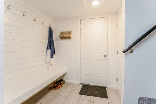 Stairs to lower level with access to two car garage - 21 Moon Compass Lane Sandwich Cape Cod - New England Vacation Rentals