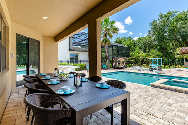 Dine al fresco under the covered patio with seating for 8