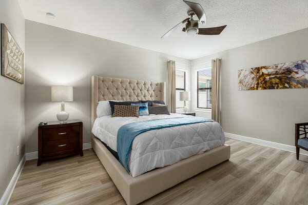 Second floor Master Suite furnished with a king-size bed