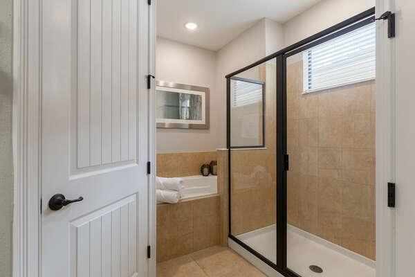 Ensuite bathroom has a walk-in shower