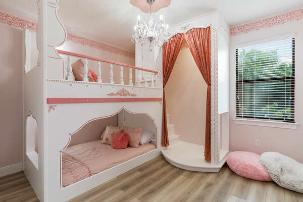 Princesses will enjoy their slumber in the Princess-themed bedroom furnished with two full-size bunked beds