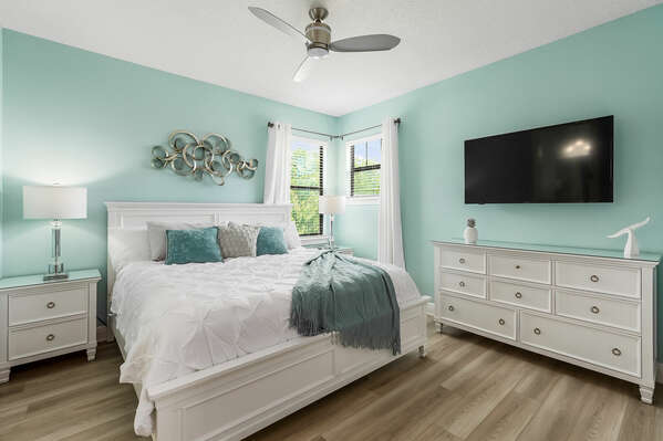 Second floor Master Suite furnished with king-size bed