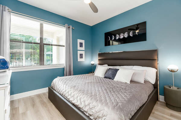 First floor Master Suite furnished with king-size bed