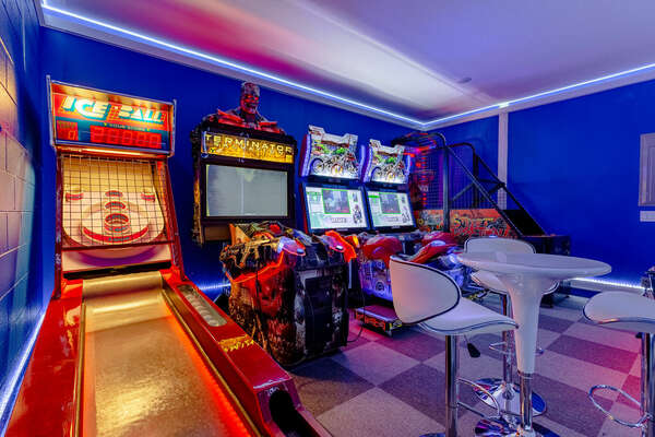 Game room includes commercial Air Hockey table, Basketball, Ice Ball, Terminator, and Dead Heat Rider arcade games