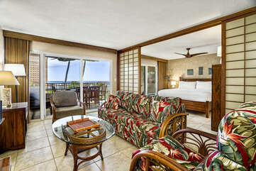 Living room at this Kona condo vacation rental with couch and two chairs.