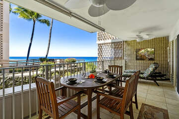 Oceanview lanai with dining table.