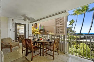 Dining area located on the lanai of this Kona condo vacation rental.