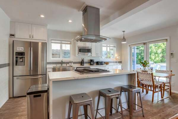 Kitchen w/ Cooking Island & Barstool Seating