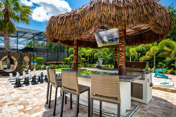 Sit at the tiki bar and enjoy a delicious meal