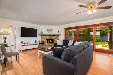 Comfortable Living Room with Plenty of Natural Light and Patio Access
