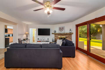 Spacious Living Room with a Queen Sleeper Sofa and Hardwood Floors