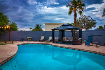 Lounge Chairs, Cabana, BBQ and Fire Pit, and a Refreshing Swimming Pool