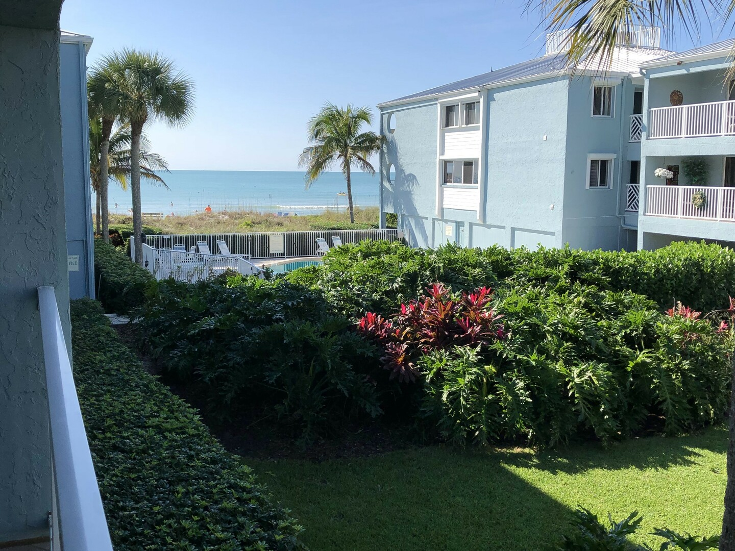 View of the pool and the beach from 105 Tiffany Place.