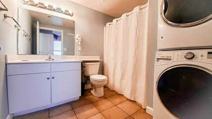 Bathroom adjacent to the bunk bed area with washer and dryer