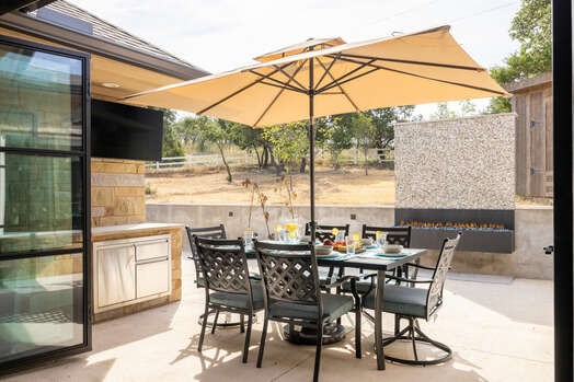 Outdoor Dining with a Gas Fireplace, Mini Fridge and Smart TV