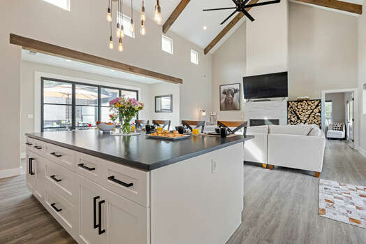 Living room, dining room and center island in gourmet display kitchen