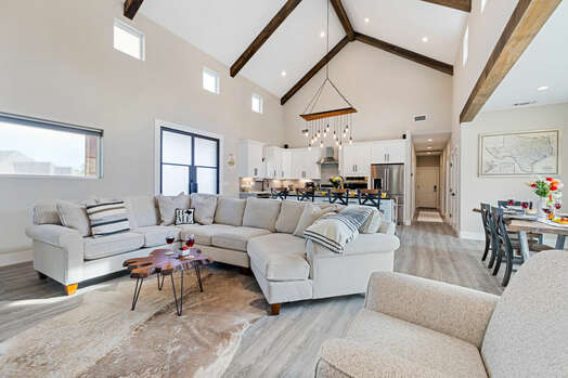 Grand hall with cozy dining room, living room and kitchen