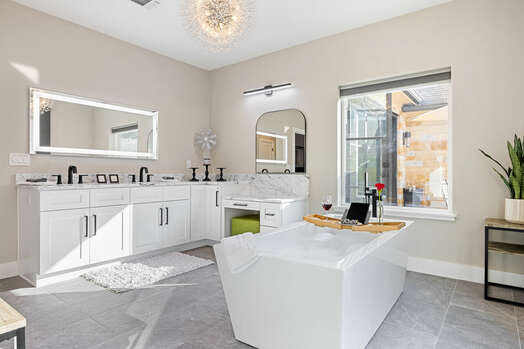 Luxury Master Bath with a Lighted Mirror, Dual Sinks and a Soaking Tub