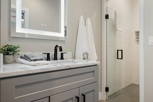 Master Bath 3 with a Vanity and Lighted Mirror and Shower