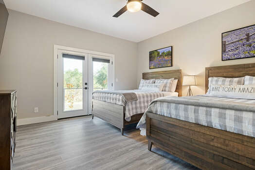 Master Bedroom 3 with Two Queen Beds and Patio Access