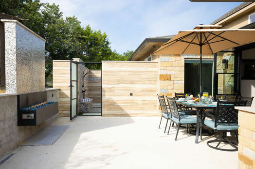 Patio with a Gas Fireplace and Access to Outdoor Shower