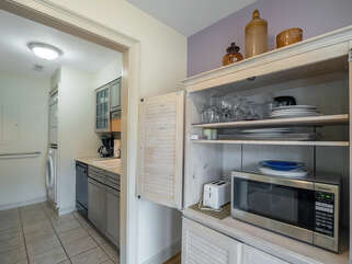 The buffet has a microwave and toaster, freeing up the kitchen counter.  Extra storage is in the buffet.