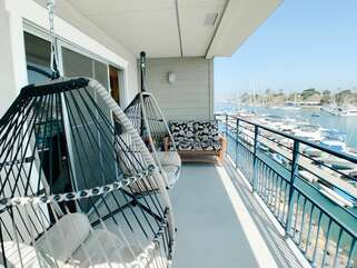 Enjoy the views of the Oceanside Harbor on these large hanging egg chairs.