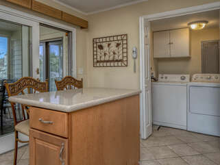The laundry room with full size washer and dryer is off the kitchen.