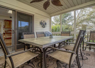 Off the kitchen sliding doors lead to the screen porch.