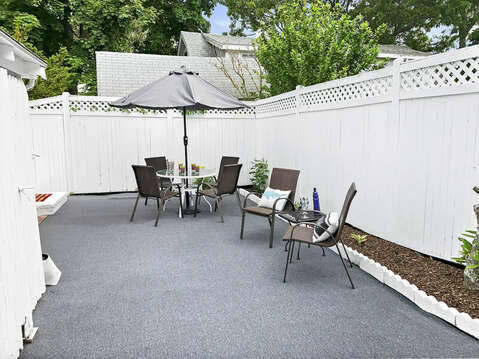 Fenced in back yard patio at-25 Zylpha Rd Harwich Port- Cape Cod- New England Vacation Rentals