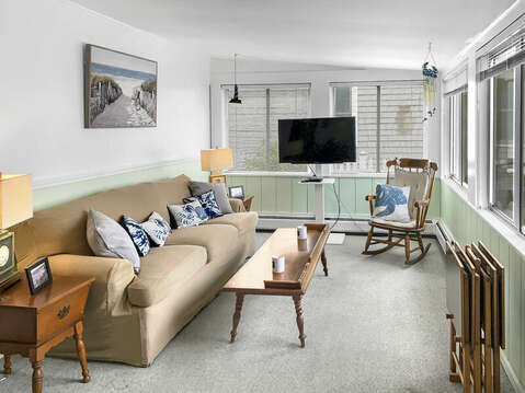 Front porch with couch and flat screen tv-25 Zylpha Rd Harwich Port- Cape Cod- New England Vacation Rentals