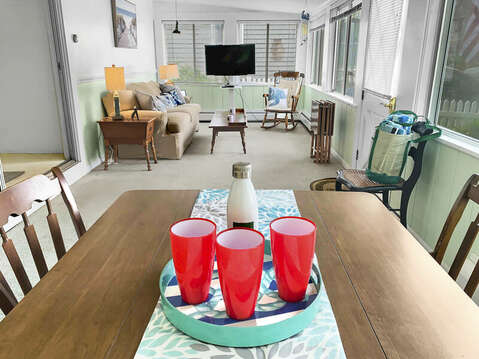 Front porch with dining and couch with flat screen tv-25 Zylpha Rd Harwich Port- Cape Cod- New England Vacation Rentals