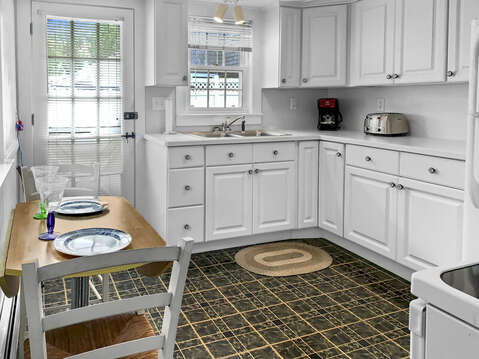 Kitchen and entrance to back yard and patio-25 Zylpha Rd Harwich Port- Cape Cod- New England Vacation Rentals